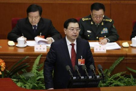 China's parliament chief Zhang Dejiang delivers a work report during the second plenary session of China's parliament, the National People's Congress, at the Great Hall of the People in Beijing, March 8, 2015. REUTERS/Jason Lee