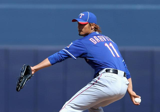 PEORIA, AZ - MARCH 07: Starting pitcher Yu Darvish #11 of the Texas Rangers pitches against the San Diego Padres during the spring training game at Peoria Stadium on March 7, 2012 in Peoria, Arizona. (Photo by Christian Petersen/Getty Images)