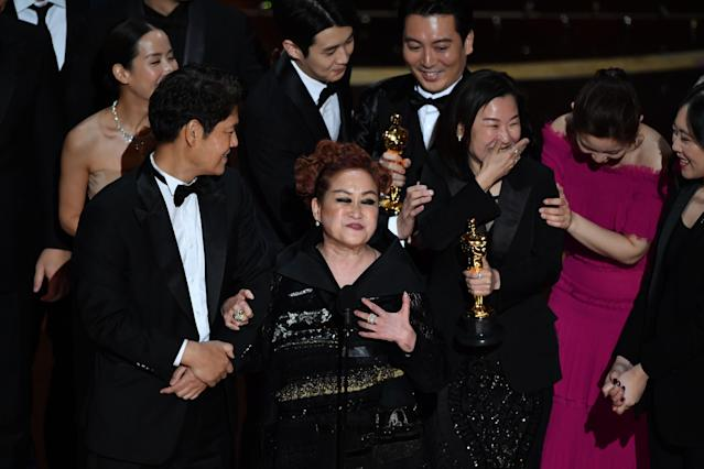 The cast and producers of Parasite accept the award for Best Picture at the Oscars on Feb. 9, 2020. (Photo by MARK RALSTON/AFP via Getty Images)