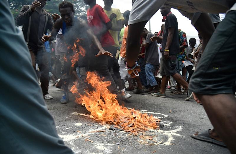 Several hundred protesters marched on Saturday in Port-au-Prince demanding the departure not just of Lafontant, but also of Moise (AFP Photo/HECTOR RETAMAL)