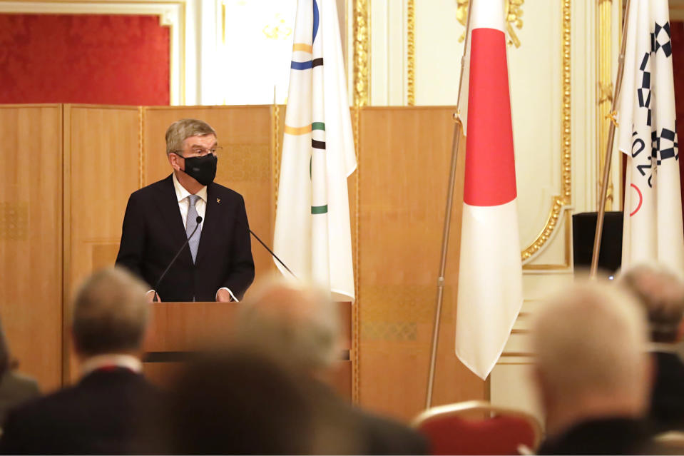 IOC President Thomas Bach, center, speaks during a welcome party for Bach and IOC officials at Akasaka Palace, Japanese state guest house, in Tokyo, Japan, Sunday, July 18, 2021.(Courtesy of Tokyo 2020 via AP)