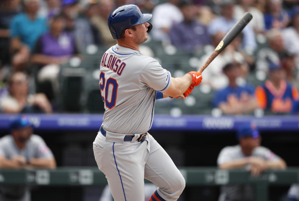 New York Mets' Pete Alonso follows the flight of his solo home run off Colorado Rockies starting pitcher Jeff Hoffman in the sixth inning of a baseball game Wednesday, Sept. 18, 2019, in Denver. (AP Photo/David Zalubowski)