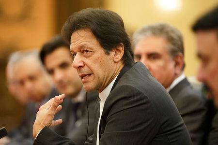 FILE PHOTO: Pakistani Prime Minister Imran Khan attends talks with Chinese President Xi Jinping (not pictured) at the Great Hall of the People in Beijing, November 2, 2018.  REUTERS/Thomas Peter/File Photo