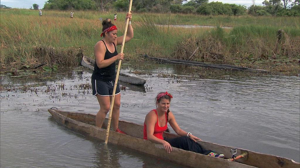 """Be Safe and Don't Hit a Cow"" -- In this Road Block, Roller Derby moms Beth (left) and Mona (right) must propel a Mokoro, a traditional canoe, down the Thamalakane River to a near by village where they will exchange two goats for the next clue, on ""The Amazing Race."""