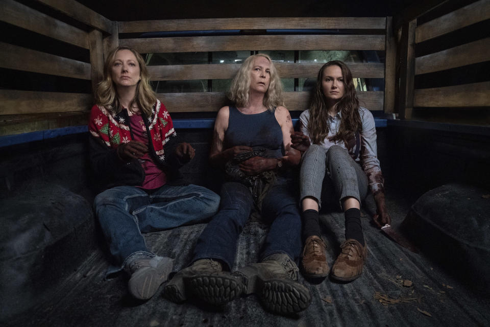 """This image released by Universal Pictures shows Judy Greer, from left, Jamie Lee Curtis and Andi Matichak in """"Halloween Kills,"""" directed by David Gordon Green. (Ryan Green/Universal Pictures via AP)"""