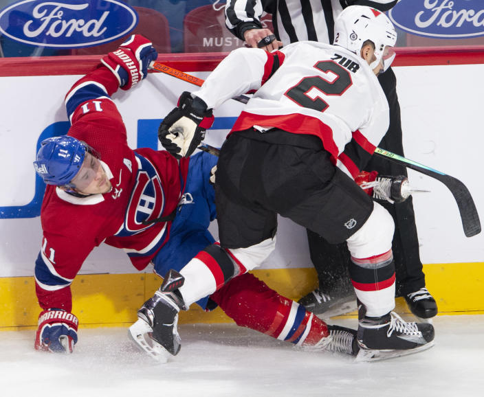 Montreal Canadiens right wing Brendan Gallagher (11) is checked by Ottawa Senators defenseman Artem Zub (2) during the second period of an NHL hockey game Tuesday, March 2, 2021, in Montreal. (Ryan Remiorz/The Canadian Press via AP)