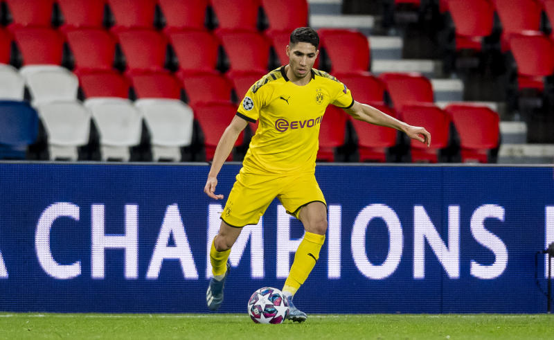 PARIS, FRANCE - MARCH 11: Achraf Hakimi of Borussia Dortmund controls the ball during the UEFA Champions League round of 16 second leg match between Paris Saint-Germain and Borussia Dortmund at Parc des Princes on March 11, 2020 in Paris, France. The match is played behind closed doors as a precaution against the spread of COVID-19 (Coronavirus). (Photo by Alexandre Simoes/Borussia Dortmund via Getty Images)
