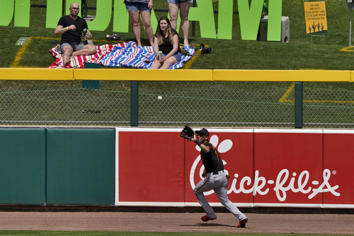 San Francisco Giants' Mauricio Dubón catches a fly-out hit by Oakland Athletics' Mitch Moreland during the second inning of a spring training baseball game, Monday, March 29, 2021, in Mesa, Ariz. (AP Photo/Matt York)