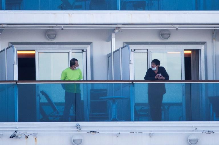 Passengers on the Diamond Princess are mostly confined to their cabins (AFP Photo/Behrouz MEHRI)
