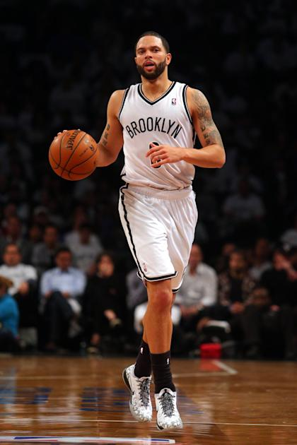 May 2, 2014; Brooklyn, NY, USA; Brooklyn Nets point guard Deron Williams (8) controls the ball against the Toronto Raptors during the third quarter of game six of the first round of the 2014 NBA Playoffs at Barclays Center. The Nets defeated the Raptors 97-83. (Brad Penner-USA TODAY Sports)