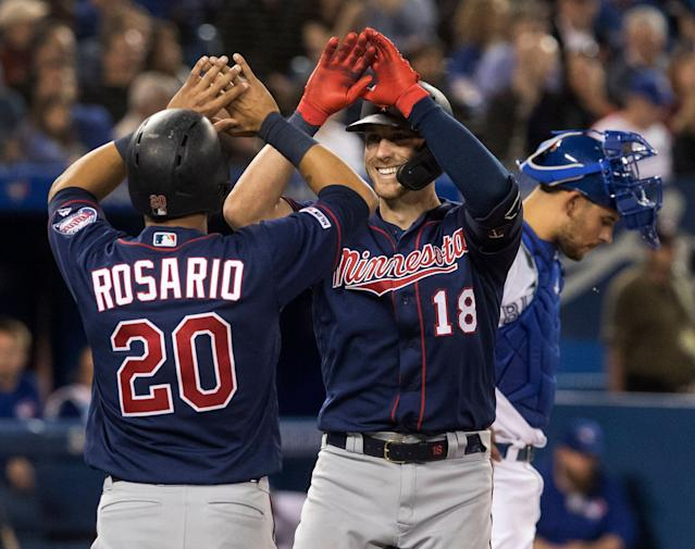 "<a class=""link rapid-noclick-resp"" href=""/mlb/players/9591/"" data-ylk=""slk:Eddie Rosario"">Eddie Rosario</a> is one of 2019's high-five leaders (Fred Thornhill/The Canadian Press via AP)"