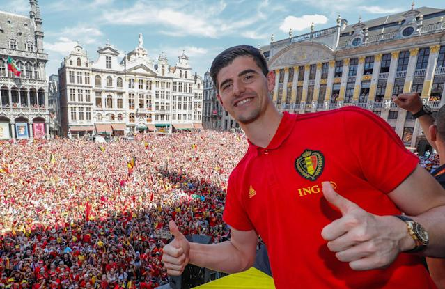 Thibaut Courtois poses above a sea of fans in Belgium after a third-place finish at the 2018 World Cup. (Getty)