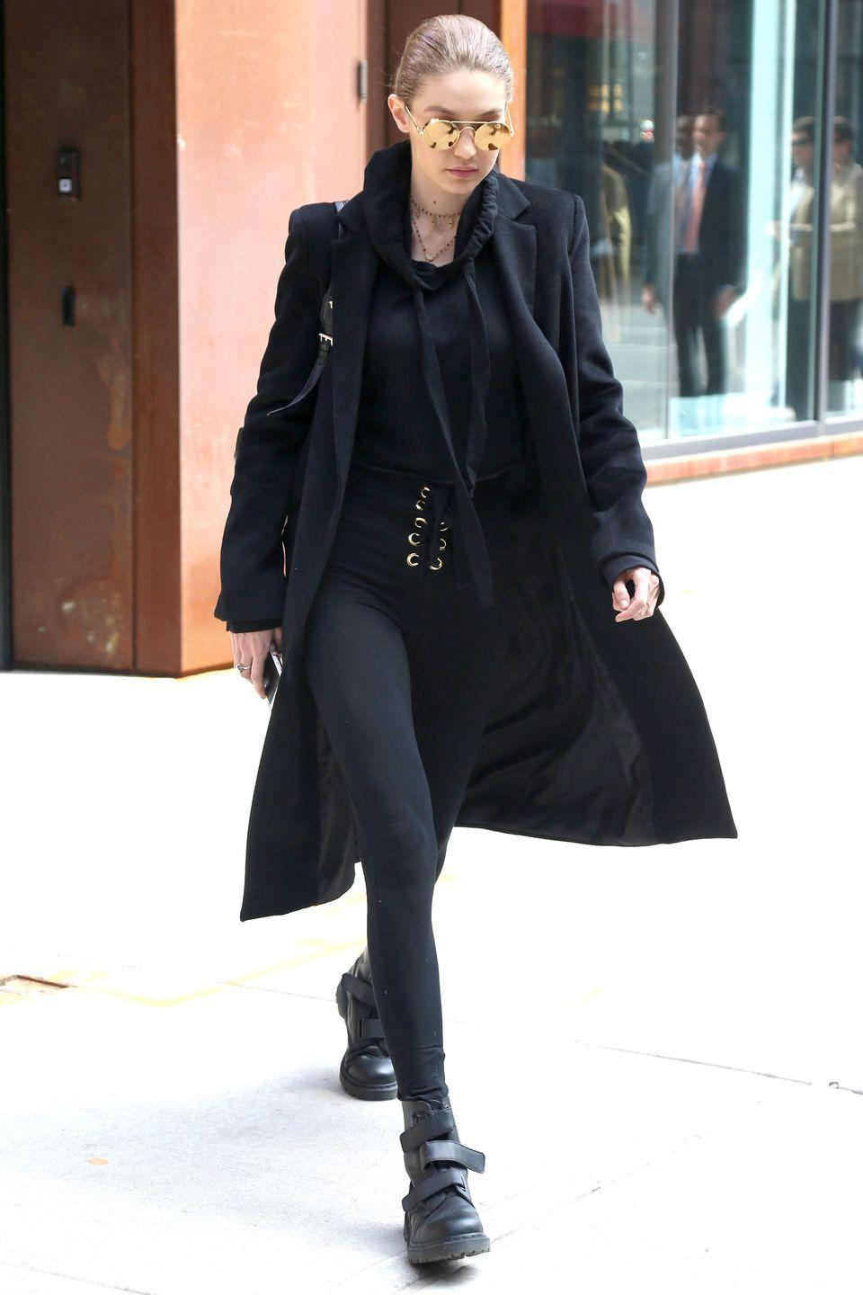 <p>In black Are You Am I lace-up leggings and a cropped sweatshirt, a Winonah blazer coat, Dr. Martens boots and mirrored Linda Farrow aviators while out in New York. </p>