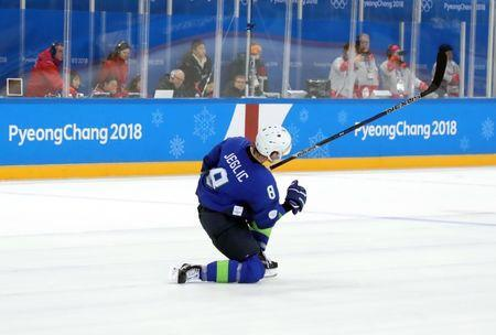 Feb 17, 2018; Gangneung, South Korea; Slovenia forward Ziga Jeglic (8) celebrates a goal Slovakia goaltender Branislav Konrad (not pictured) in a shoot out in men's ice hockey group B play during the Pyeongchang 2018 Olympic Winter Games at Kwandong Hockey Centre. Mandatory Credit: Geoff Burke-USA TODAY Sports
