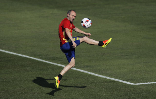 FILE - In this June 23, 2016 file photo, Spain's Andres Iniesta controls the ball during a training session at the Sports Complex Marcel Gaillard in Saint Martin de Re in France. The elegance and precise passes of Andres Iniesta, the personality and stout defense of Sergio Ramos and the intelligence and scoring touch of David Silva will all be on display again at the World Cup, but mostly likely for the last time. (AP Photo/Manu Fernandez, File)