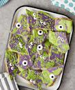 """<p>This crispy, crunchy dessert gives a whole new meaning to the phrase, """"Monster Mash""""! Purple and green candy melts mix with candy eyeballs and colored sprinkles, and the result is a whimsical, monster-inspired bark your kids will gobble up.</p><p><strong><a href=""""https://www.thepioneerwoman.com/food-cooking/recipes/a34030001/monster-bark-recipe/"""" rel=""""nofollow noopener"""" target=""""_blank"""" data-ylk=""""slk:Get the recipe."""" class=""""link rapid-noclick-resp"""">Get the recipe.</a></strong> </p><p><a class=""""link rapid-noclick-resp"""" href=""""https://go.redirectingat.com?id=74968X1596630&url=https%3A%2F%2Fwww.walmart.com%2Fbrowse%2Fhome%2Ffood-storage-containers%2Fthe-pioneer-woman%2F4044_623679_1032619_5842891%2FYnJhbmQ6VGhlIFBpb25lZXIgV29tYW4ie&sref=https%3A%2F%2Fwww.thepioneerwoman.com%2Ffood-cooking%2Fmeals-menus%2Fg32110899%2Fbest-halloween-desserts%2F"""" rel=""""nofollow noopener"""" target=""""_blank"""" data-ylk=""""slk:SHOP FOOD STORAGE"""">SHOP FOOD STORAGE</a></p>"""