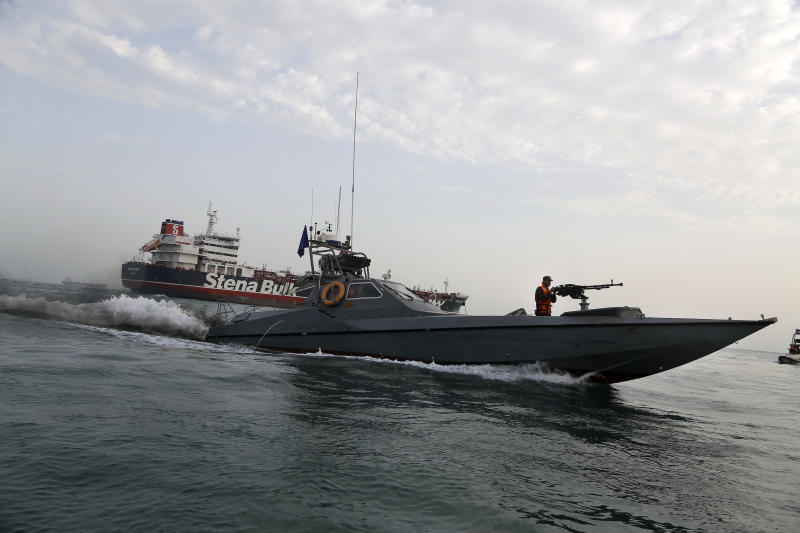 A speedboat of the Iran's Revolutionary Guard moves around a British-flagged oil tanker Stena Impero, which was seized on Friday by the Guard, in the Iranian port of Bandar Abbas, Sunday, July 21, 2019. Iranian officials say the seizure of the British oil tanker was a justified response to Britain's role in impounding an Iranian supertanker two weeks earlier off the coast of Gibraltar, a British territory located on the southern tip of Spain. (Hasan Shirvani/Mizan News Agency via AP)