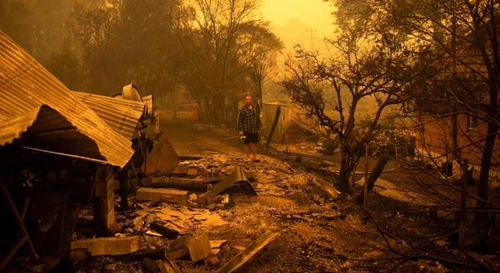 Gary Hinton was among those who fled the New South Wales town of Cobargo as fires raced through. He returned to a scene of devastation (AFP Photo/SEAN DAVEY)