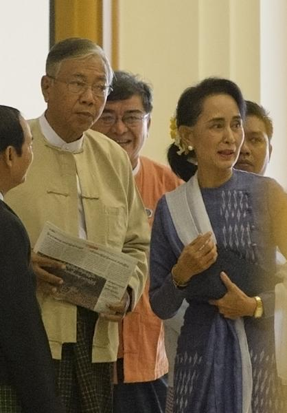 Myanmar's new leadership, steered by Aung San Suu Kyi (R) and her presidential proxy Htin Kyaw (L), will take office at the end of the month (AFP Photo/Ye Aung Thu)