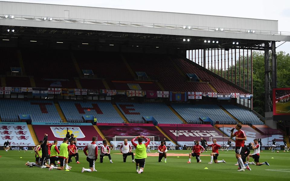 General view inside the stadium as Sheffield United players warm up prior to the Premier League match between Aston Villa and Sheffield United at Villa Park - GETTY IMAGES