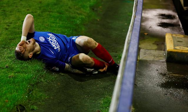 Soccer Football - FA Cup First Round Replay - Tranmere Rovers vs Peterborough United - Prenton Park, Birkenhead, Britain - November 15, 2017 Peterborough United's Marcus Maddison after sustaining an injury Action Images/Jason Cairnduff