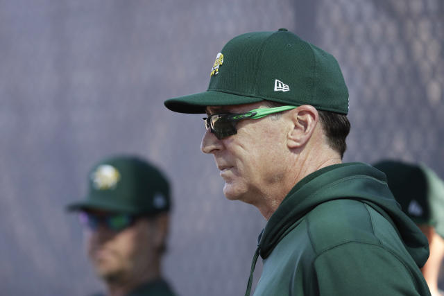 Oakland Athletics manager Bob Melvin watches as pitchers throw during spring training baseball, Wednesday, Feb. 12, 2020, in Mesa, Ariz. (AP Photo/Darron Cummings)