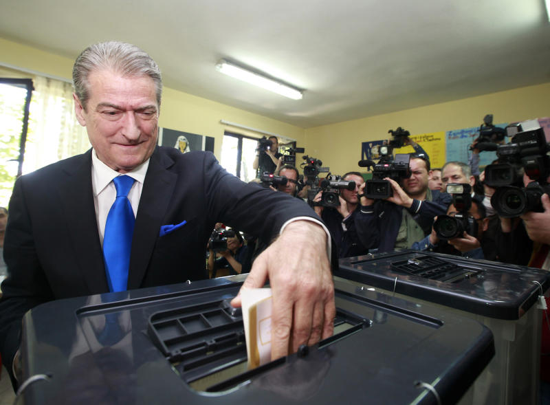Albania's Prime Minister Sali Berisha casts his ballot for the local elections in capital Tirana, Sunday, May 8, 2011. Albanians have started to cast ballots to elect the local authorities after a campaign marred by political violence. (AP Photo/Hektor Pustina)