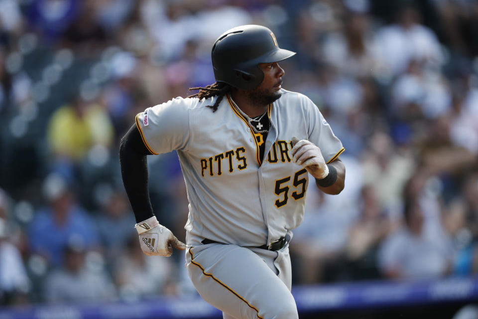 Pittsburgh Pirates' Josh Bell hustles up the first-base line after singling off Colorado Rockies relief pitcher Jairo Diaz in the ninth inning of a baseball game Sunday, Sept. 1, 2019, in Denver. (AP Photo/David Zalubowski)
