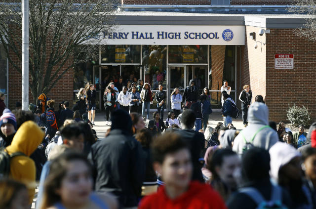 <p>Students file out of Perry Hall High School in Perry Hall, Md., Wednesday, March 14, 2018, during a student walkout. Students across the country planned to participate in walkouts Wednesday to protest gun violence, one month after the deadly shooting inside a high school in Parkland, Florida. (Photo: Patrick Semansky/AP) </p>