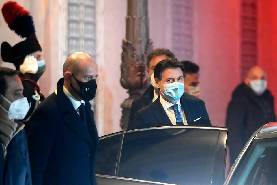 Italy's Prime Minister Giuseppe Conte (C) leaves the Palazzo Madama in Rome on January 19, 2021 after a confidence vote against him and his gouvernment before the Italian Senate. - Italian Prime Minister Giuseppe Conte pleaded for lawmakers' support on January 19, 2021 as his teetering government faced a confidence vote while it struggles to battle the coronavirus pandemic. The ruling coalition has been on the brink of collapse since former premier Matteo Renzi withdrew his Italia Viva party last week, depriving Conte of his majority in the upper chamber. (Photo by Filippo MONTEFORTE / AFP) (Photo by FILIPPO MONTEFORTE/AFP via Getty Images) (Photo: FILIPPO MONTEFORTE via Getty Images)