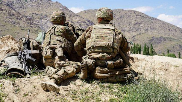 PHOTO: In this photo taken on June 6, 2019, US soldiers look out over hillsides during a visit of the commander of US and NATO forces in Afghanistan General Scott Miller at the Afghan National Army (ANA) checkpoint in Nerkh district of Wardak province. (Thomas Watkins/AFP/Getty Images)