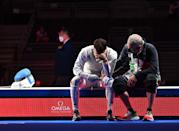 <p>Italy's Daniele Garozzo (L) is consolate by his coach Fabio Maria Galli after loosing against Hong Kong's Cheung Ka Long in the mens individual foil gold medal bout during the Tokyo 2020 Olympic Games at the Makuhari Messe Hall in Chiba City, Chiba Prefecture, Japan, on July 26, 2021. (Photo by Fabrice COFFRINI / AFP) (Photo by FABRICE COFFRINI/AFP via Getty Images)</p>