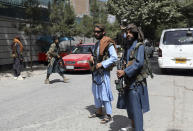 """Taliban fighters stand guard at a checkpoint in the Wazir Akbar Khan neighborhood in the city of Kabul, Afghanistan, Wednesday, Aug. 18, 2021. The Taliban declared an """"amnesty"""" across Afghanistan and urged women to join their government Tuesday, seeking to convince a wary population that they have changed a day after deadly chaos gripped the main airport as desperate crowds tried to flee the country. (AP Photo/Rahmat Gul)"""