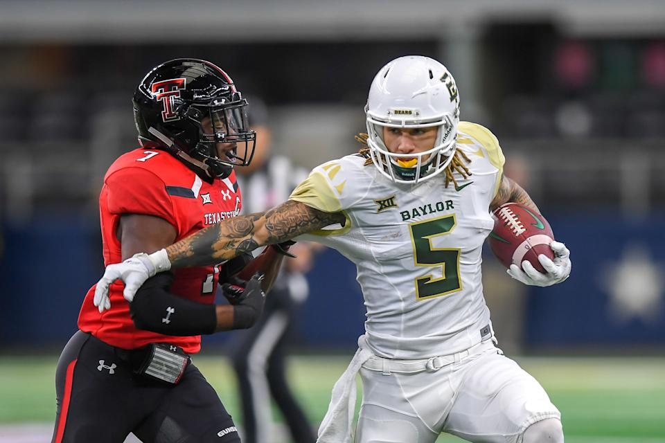 LUBBOCK, TX - NOVEMBER 24: Wide receiver Jalen Hurd #5 of the Baylor Bears tries to get past defensive back Jah'Shawn Johnson #7 of the Texas Tech Red Raiders during the first half of the game on November 24, 2018 at  AT&T Stadium in Arlington, Texas. (Photo by John Weast/Getty Images)