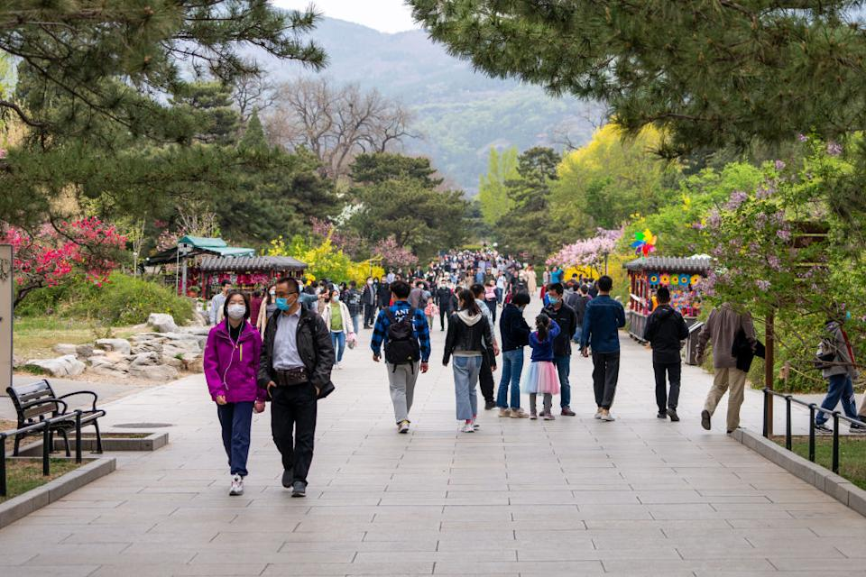 BEIJING, CHINA - APRIL 13, 2021: People walk in the Beijing Botanical Garden. Beijing has not registered any local COVID-19 cases for over 70 days; over 10 mln Beijing residents have received at least one COVID-19 vaccine dose. Artyom Ivanov/TASS (Photo by Artyom Ivanov\TASS via Getty Images)