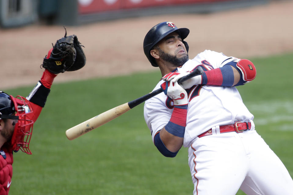 Minnesota Twins designated hitter Nelson Cruz reacts after getting hit by a pitch from Boston Red Sox starting pitcher Nathan Eovaldi in the first inning of a baseball game, Wednesday, April 14, 2021, in Minneapolis. (AP Photo/Andy Clayton-King)