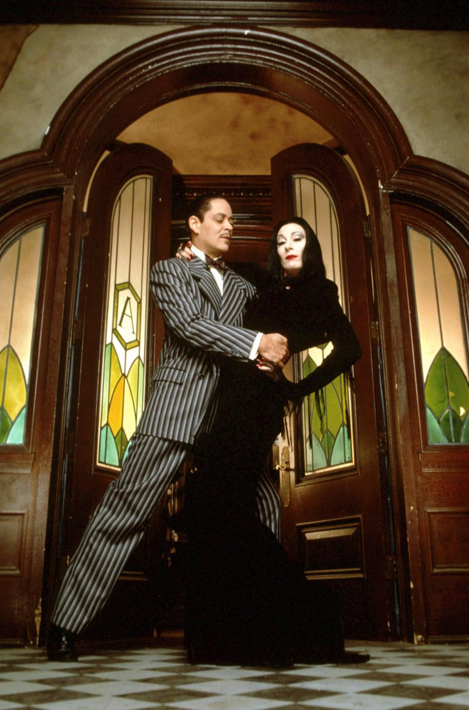 <p><strong>For Gomez:</strong> A pinstripe suit.</p> <p><strong>For Morticia:</strong> A long black gown with a deep V neckline.</p>