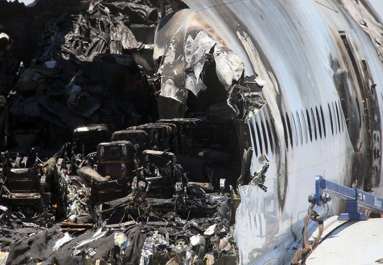 Burned seats are visible in the wrecked fuselage of Asiana Airlines flght 214 on July 12, 2013