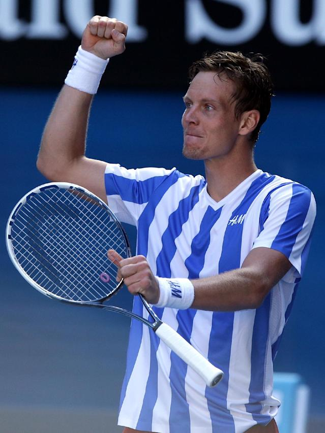 Tomas Berdych of the Czech Republic celebrates after defeating David Ferrer of Spain in their quarterfinal at the Australian Open tennis championship in Melbourne, Australia, Tuesday, Jan. 21, 2014.(AP Photo/Aaron Favila)