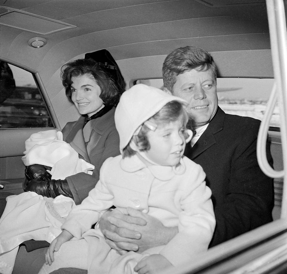 <p>The President and First Lady ride together with Caroline and John F. Kennedy, Jr.<br></p>