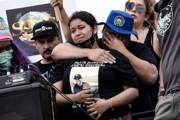 PHOTO: Jennifer Guardado, Andres Guardado's sister, is embraced by her cousin Steve Abarca after she delivered a speech during a protest against the death of Andres Guardado in an officer involved shooting, in Compton, Calif., June 28, 2020. (Etienne Laurent/EPA via Shutterstock)