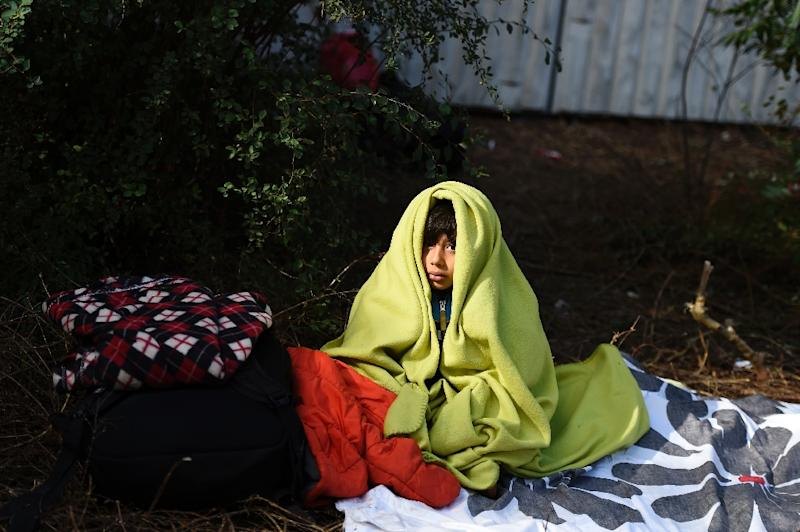 A refugee from Afghanistan waits outside the State Office of Health and Social Affairs in Berlin where hundreds of migrants wait to receive help on September 29, 2015 (AFP Photo/Tobias Schwarz)