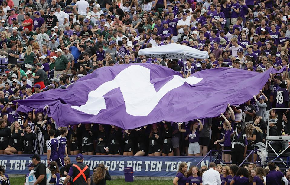 EVANSTON, ILLINOIS - SEPTEMBER 21: Student fans wave a Northwestern flag during a game between the Northwestern Wildcats and the Michigan State Spartans at Ryan Field on September 21, 2019 in Evanston, Illinois. (Photo by Jonathan Daniel/Getty Images)