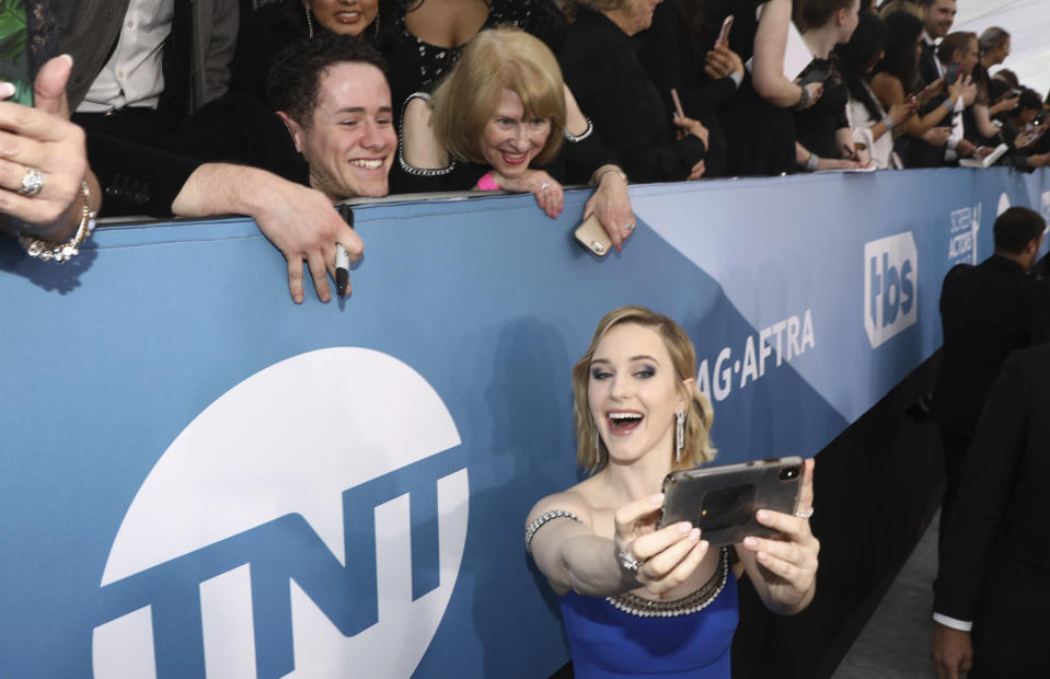 Rachel Brosnahan takes a selfie with fans as she arrives at the 26th annual Screen Actors Guild Awards at the Shrine Auditorium & Expo Hall on Sunday, Jan. 19, 2020, in Los Angeles. (Photo by Matt Sayles/Invision/AP)