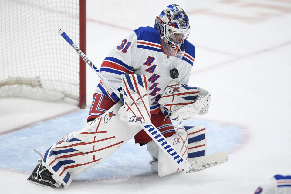 New York Rangers goaltender Igor Shesterkin (31) stops the puck during the first period of an NHL hockey game against the Washington Capitals, Saturday, Feb. 20, 2021, in Washington. (AP Photo/Nick Wass)