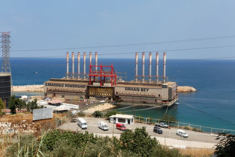 FILE PHOTO: Karadeniz Powership Orhan Bey, an electricity-generating ship from Turkey, docked at the port of Jiyeh, south of Beirut