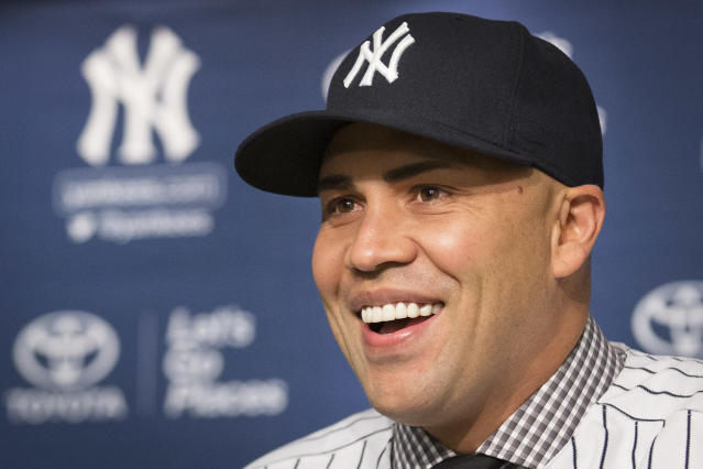 Carlos Beltran smiles during a news conference at Yankees Stadium, Friday, Dec. 20, 2013, in New York. The former St. Louis Cardinals outfielder signed with the New York Yankees on a $45 million, three-year contract. (AP Photo/John Minchillo)