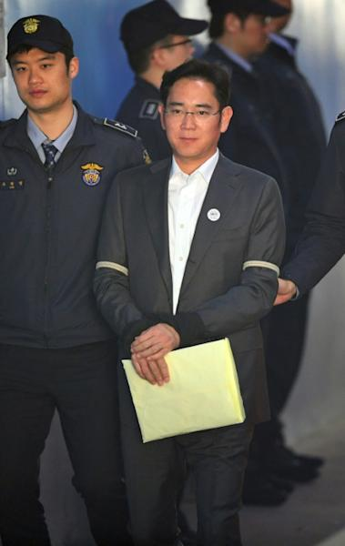 Lee Jae-Yong, the heir to the Samsung group, has been held in custody and is on trial for bribery
