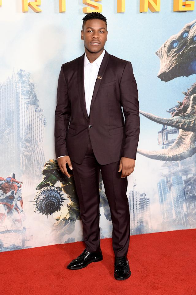 <p>The British actor, most famous for his role in the new 'Star Wars' films, took red carpet style in his stride in a maroon suit. <em>[Photo: Getty]</em> </p>