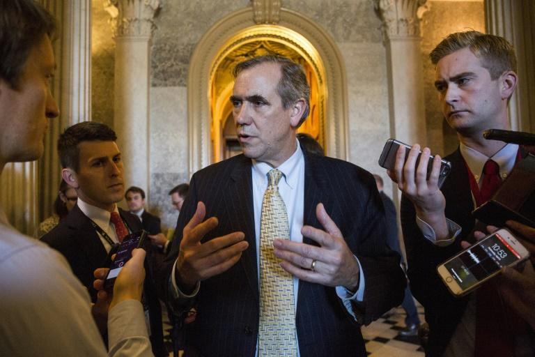 Democratic Senator Jeff Merkley talks to members of the press after speaking all night on the Senate floor in opposition to Supreme Court nominee Neil Gorsuch